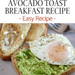 avocado spread on bread with two extra pieces of toast a sunnyside egg on top and a fork