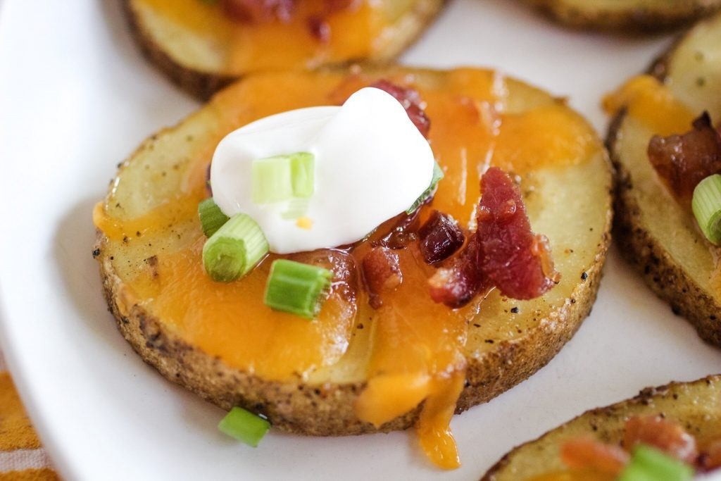 potato with cheese, bacon, sour cream and green onions