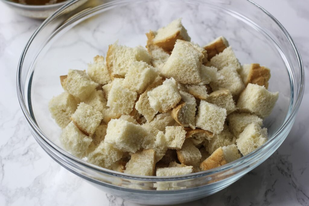cubed bread in bowl