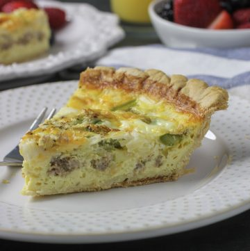 piece of quiche on plaste with fork