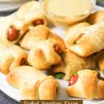 jalapeno, cream cheese and little smokes with a crescent roll wrapped around