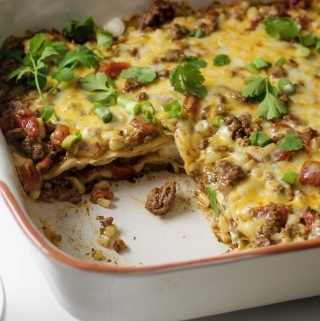 cream cheese enchilada bake in casserole dish