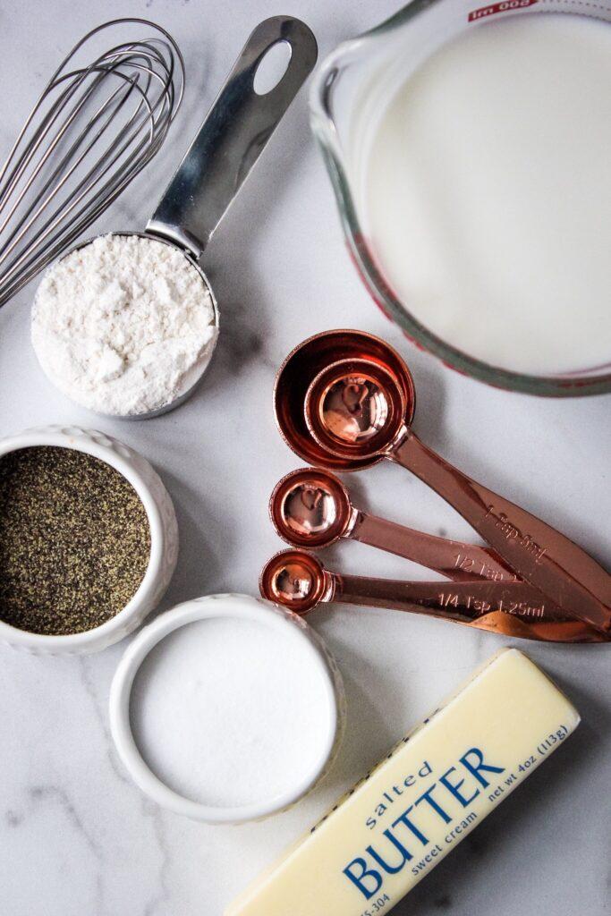 flour, salt, pepper, measuring spoons and butter for bechamel sauce