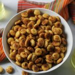 fiesta ranch oyster crackers in bowl with colorful napkin