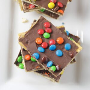 saltine toffee bars with m&m candy on plate