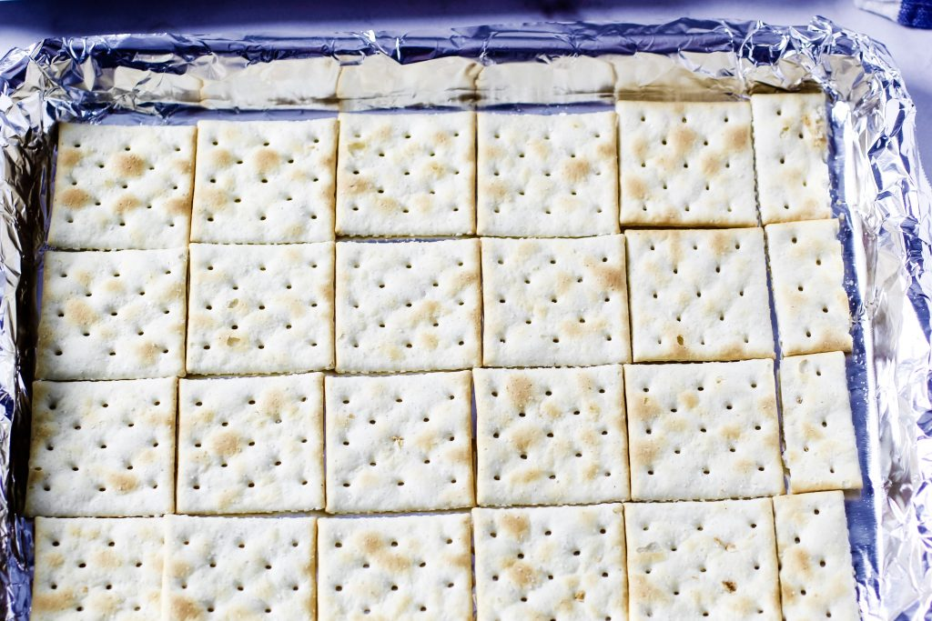 Saltine crackers on foil lined cookie sheet