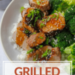 grilled asian pork tenderlion in bowl with broccoli and rice with pinterest text