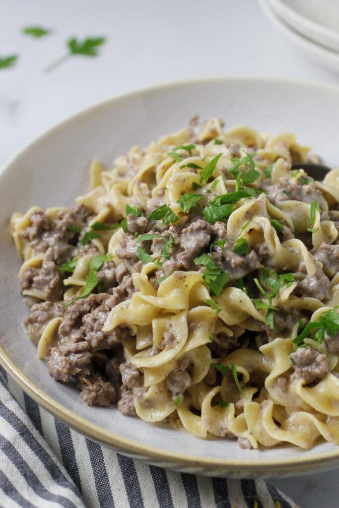 ground beef stroganoff in bowl with with napkin