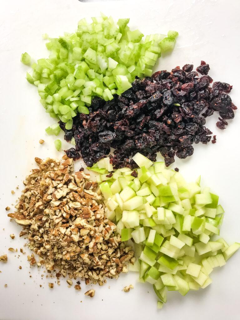 add in ingredients for sweet tuna salad on cutting board