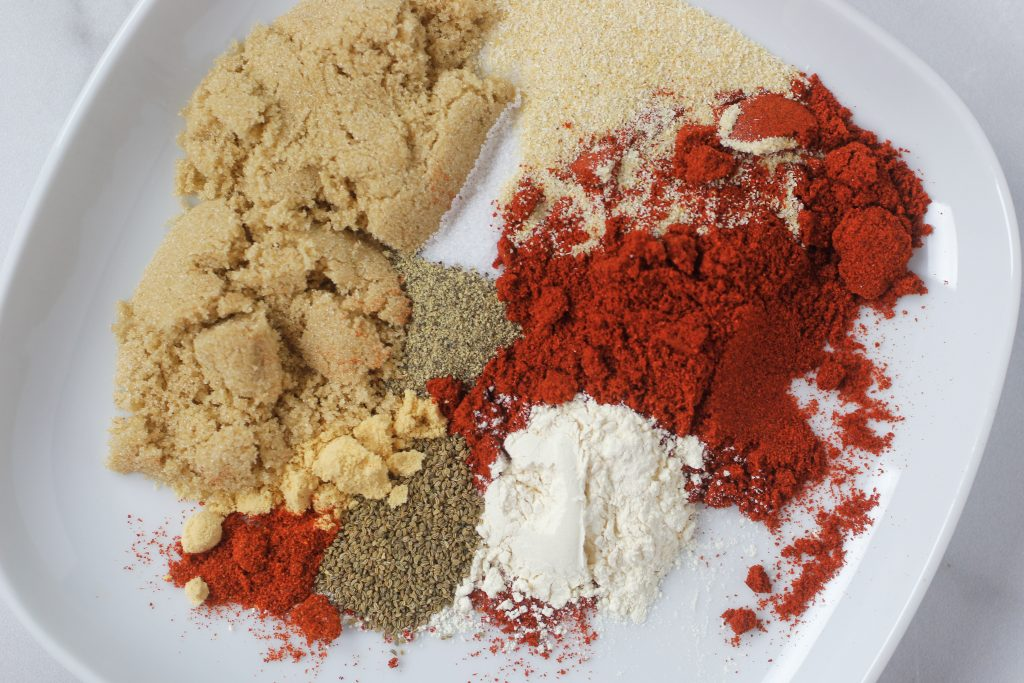 nine different spices on a plate that make up bbq blend