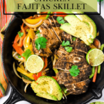chicken, avocado, bell peppers, avocado and lime in a black skillet with a kitchen towel