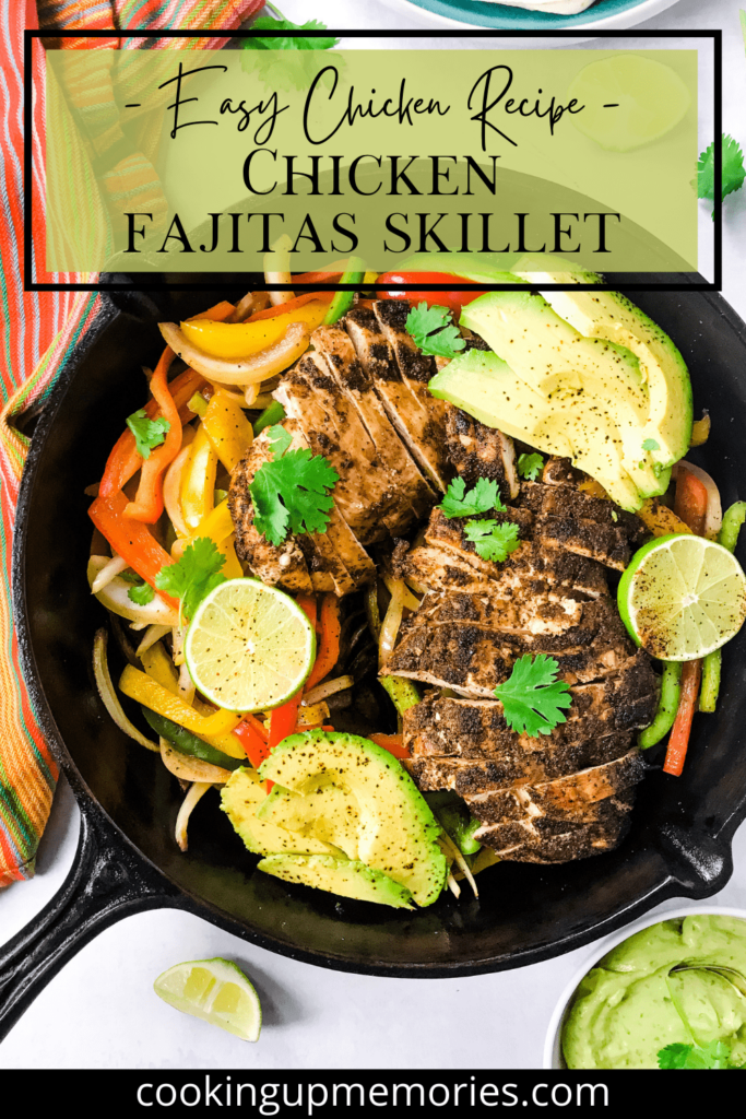 One Pot Chicken Fajita Skillet in a cast iron pan including chicken, avocado, bell peppers, avocado and lime in a black skillet with a kitchen towel