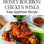 Honey Bourbon Wings on a plate with green onions for garnish and extra sauce on the side