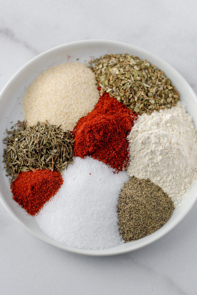 ingredients on a plate to make Cajun spice blend