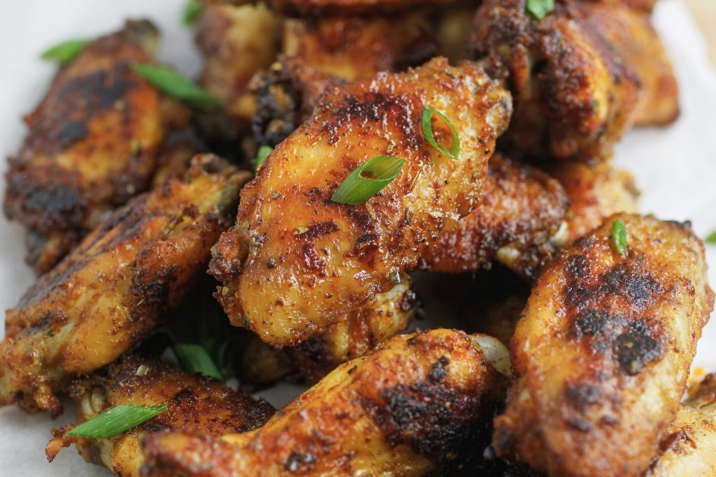 Cajun wings with green onions sprinkled on top