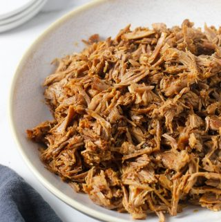 instant pot pulled pork with bowl with napkin and extra plates