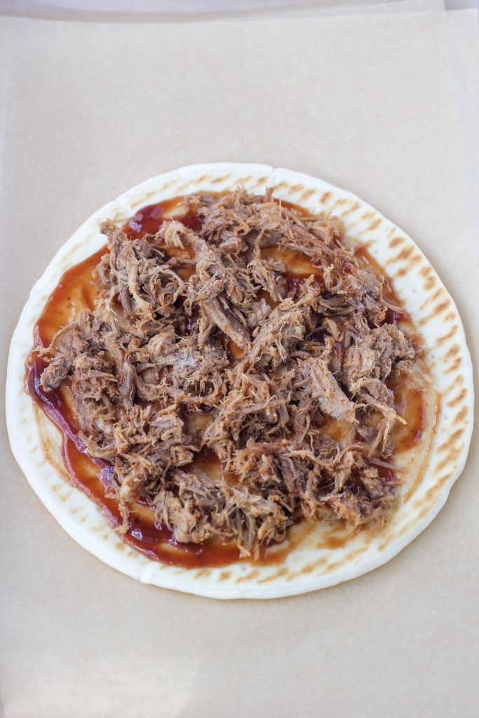 Flatbread with BBQ Sauce and pulled pork layered over the top