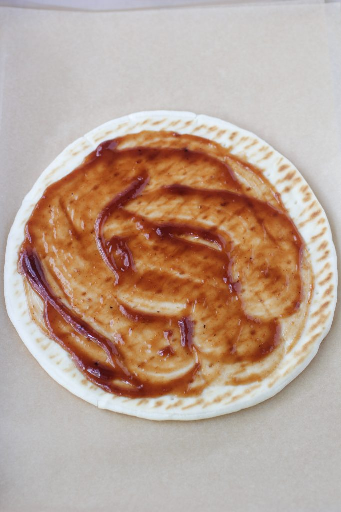 flatbread with bbq sauce spread over the top