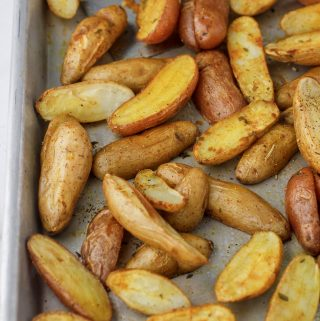 Roasted Fingerling potatoes on a cookie sheet right out of the oven