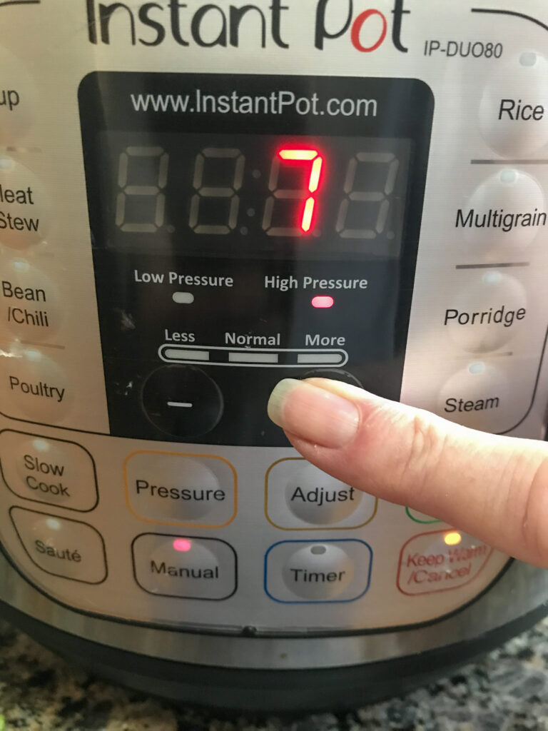 picture of instant pot with finger showing to cook on high pressure for 7 minutes.