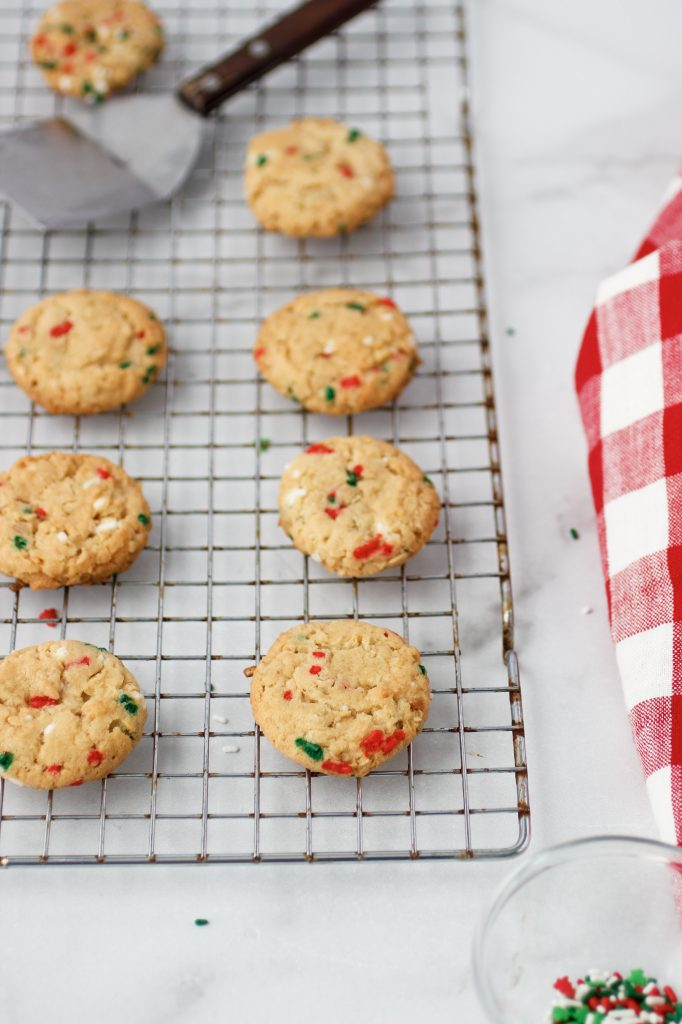baked cookies with sprinkles on cooling rack with napkin