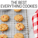 Everything Cookies on cooling rack with spatula and red and white dish cloth