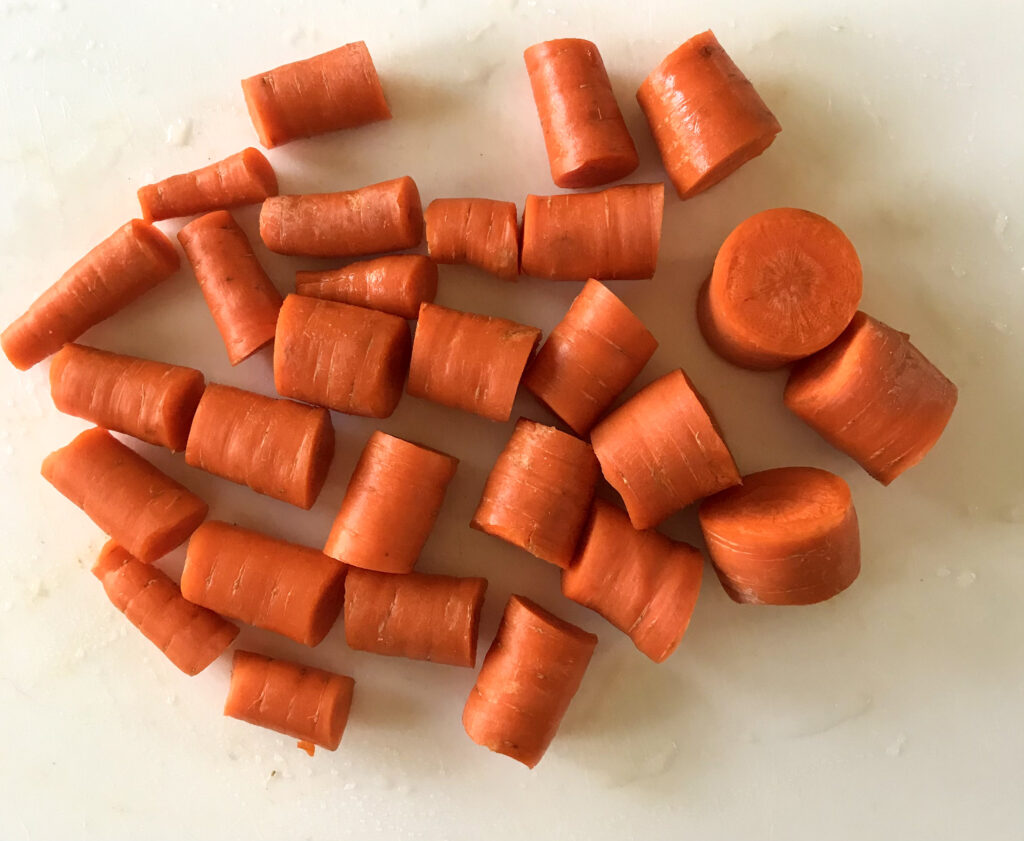 carrots on cutting board cut in 1 plus inch pieces