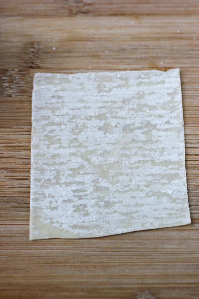 won ton wrapper on cutting board