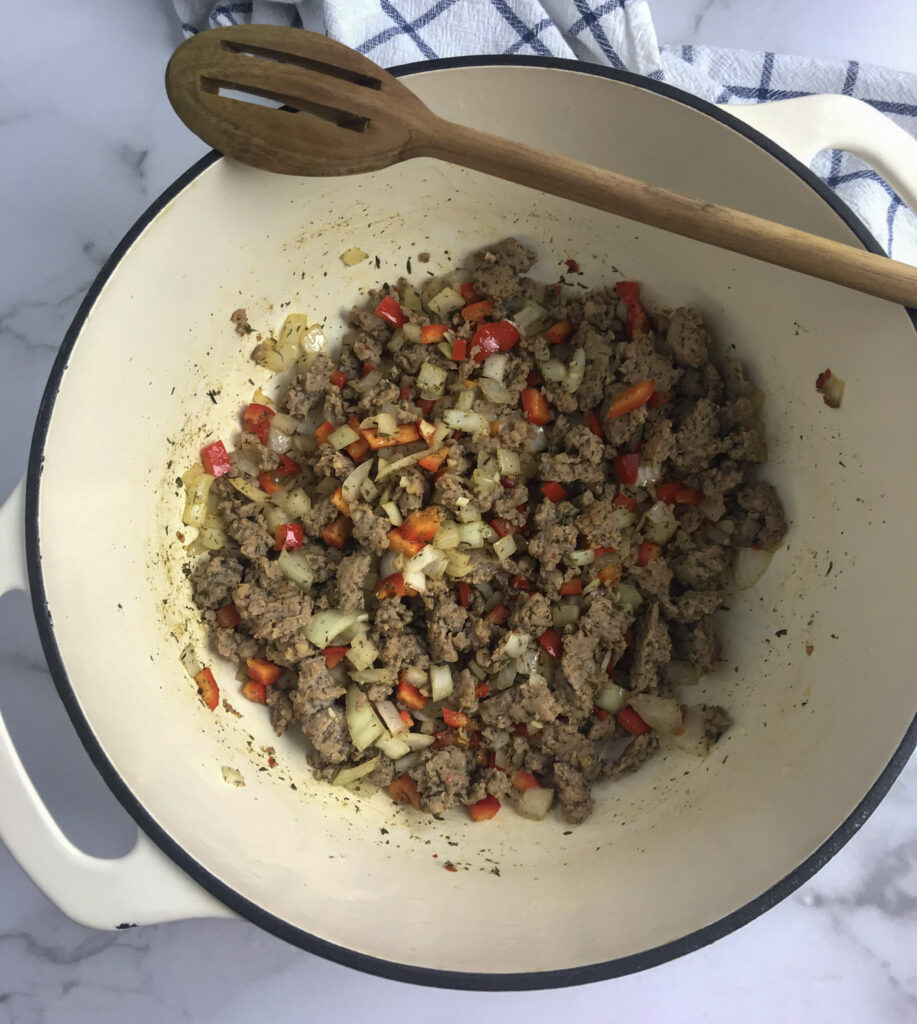 Browned Italian sausage, red bell pepper, onion and garlic with spices after saute.