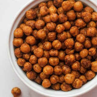 Spicey Roasted Chickpeas in a white bowl with a couple splilled out