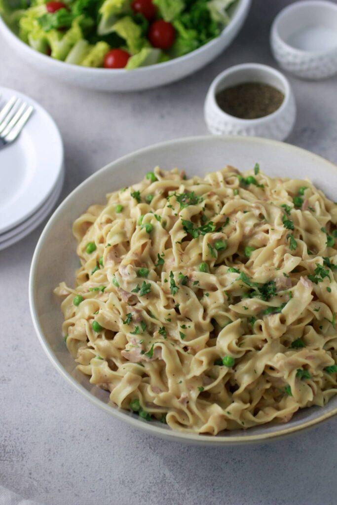 a large serving bowl with instant pot tuna noodle casserole