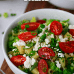 caesar pasta salad in white bowl without dressing