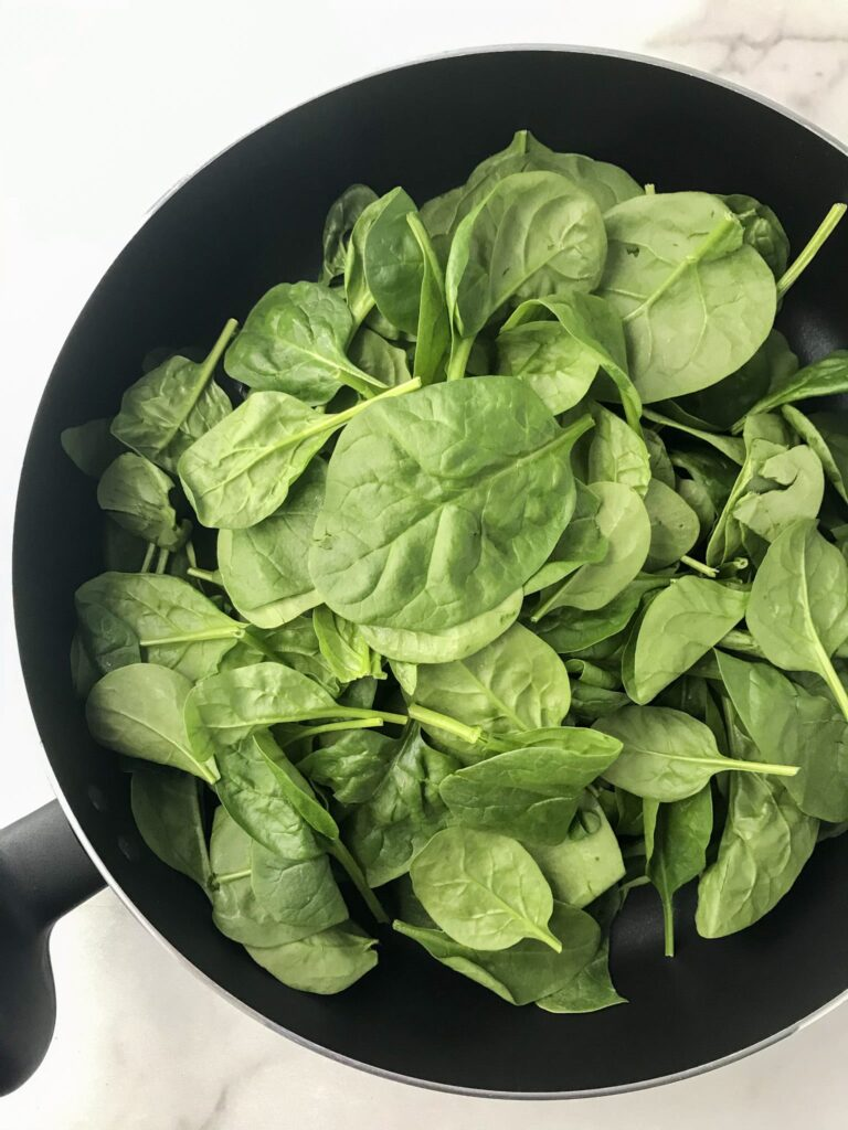baby spinach in a skillet
