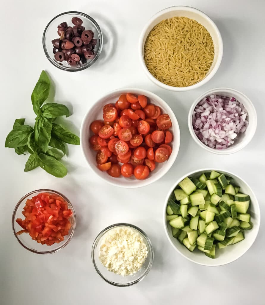 Greek Feta Salad with Orzo Recipe Ingredients in individual white bowls